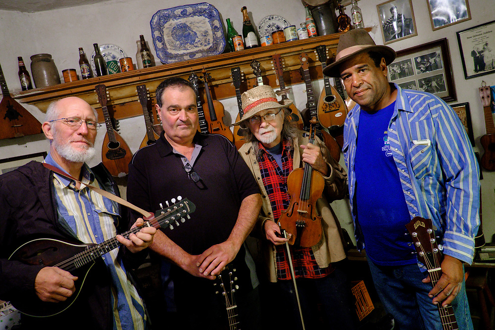 CHRISTIANA, PENNSYLVANIA - SEPTEMBER 2: Zane Campbell, second from left, poses with former band members from his group Gravel Pit Ramblers in the workshop of Chester C. Marron on Saturday, September 2, 2017 in Christiana, Pennsylvania.  Pictured (L-R): Gary Irving, Zane Campbell, Chester Marron and Sporty Dave. (Photo by Pete Marovich For The Washington Post)