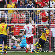 Luis Robles, New York Red Bulls, makes a fine save from Jack Wilshere, Arsenal, during the New York Red Bulls Vs Arsenal FC,  friendly football match for the New York Cup at Red Bull Arena, Harrison, New Jersey. USA. 26h July 2014. Photo Tim Clayton