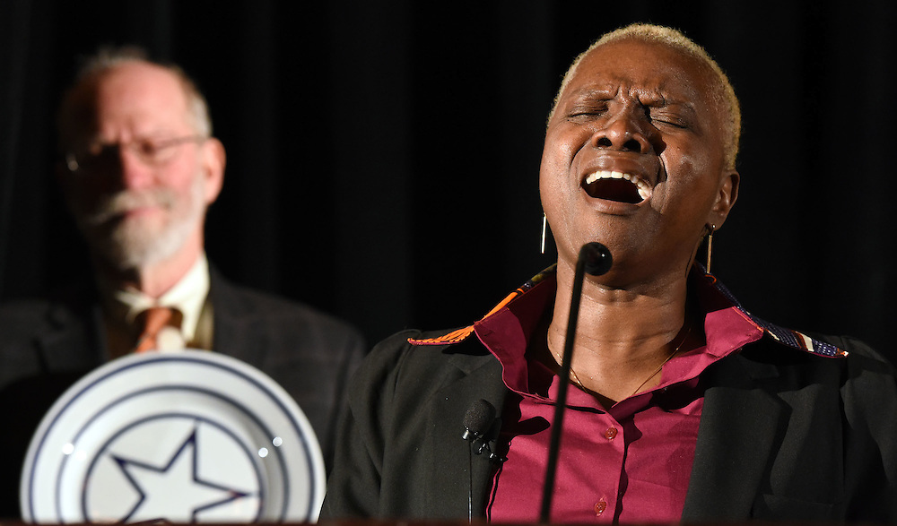 Photo by Mara Lavitt -- Special to the Hartford Courant<br /> Omni New Haven Hotel at Yale, New Haven, CT<br /> January 28, 2015<br /> Grammy Award-winning singer and UNICEF Goodwill Ambassador Angelique Kidjo was the International Festival of Arts &amp; Ideas 5th annual Visionary Leadership Award recipient. Gordon Geballe, chair of the Festival's board of directors, holds the award -- a plate designed by artist Sol Lewitt -- as Kidjo sings &quot;Blewu&quot; after receiving the award. Kidjo is co-founder of the Batonga Foundation which advocates for the rights of women and girls, especially in Africa.