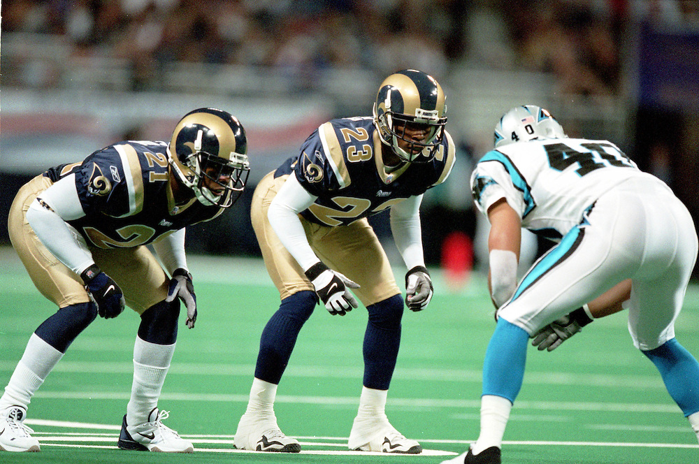 Defensive backs Dexter McCleon (21) and Jerametrius Butler (23) of the St. Louis Rams prepare to block Defensive back Jarrod Cooper (40) of the Carolina Panthers on a punt during a 48 to 14 win by the Rams on 11/11/2001..©Wesley Hitt/NFL Photos