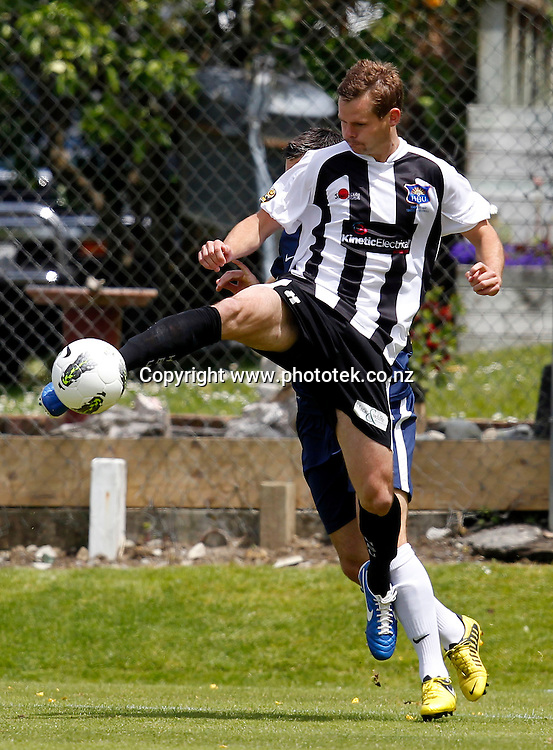Bays Cole Peverley gets to the ball ahead of Auckland's Chris Bale. ASB Premiership, Round Three, Auckland City FC v Hawkes Bay United, Kiwitea Street Auckland, Sunday 18th November 2012. Photo: Shane Wenzlick