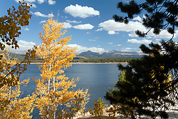 Aspens glow against the waters of Turquoise Lake in Leadville, accessed via Colorado's Top of the Rockies Scenic Byway.