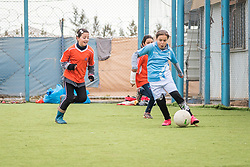 20 February 2020, Za'atari Camp, Jordan: A girl runs with the ball during football practice for girls in the Peace Oasis, a Lutheran World Federation space in the Za'atari Camp where Syrian refugees are offered a variety of activities on psychosocial support, including counselling, life skills trainings and other activities.