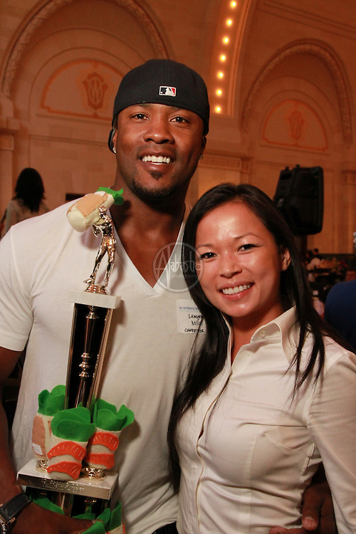 "Celebrity Spring Roll Eating Contest at ID Spring Roll 2010 ""Party Down for Chinatown"". Winner: Seattle Seahawk Safety Lawyer Milloy. Trophy created by Christina Seong."