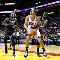 29 January 2012: Chicago Bulls center Joakim Noah (13) is fouled by Miami Heat power forward Chris Bosh (1) during the Miami Heat 97-93 victory over the Chicago Bulls at the AmericanAirlines Arena, Miami, Florida, USA.