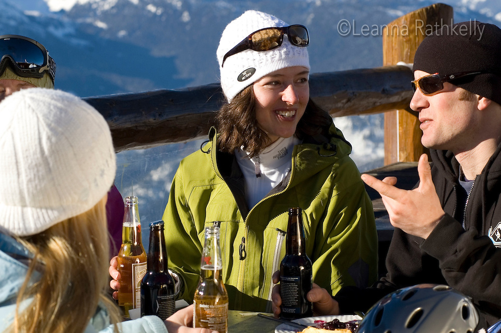 Skiers enjoy a break at the Crystal Hut on Blackcomb Mountain, sunny winter day. Whistler, BC Canada.