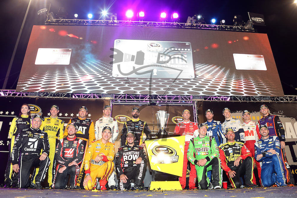 RICHMOND, VA - SEPTEMBER 12:  (Back row L-R) Matt Kenseth, driver of the #20 Dollar General Toyota, Ryan Newman, driver of the #31 Caterpillar Chevrolet, Carl Edwards, driver of the #19 ARRIS Toyota, Paul Menard, driver of the #27 Libman/Menards Chevrolet, Kevin Harvick, driver of the #4 Budweiser/Jimmy John's Chevrolet, Dale Earnhardt Jr., driver of the #88 Nationwide Chevrolet, Brad Keselowski, driver of the #2 Miller Lite Ford, Jeff Gordon, driver of the #24 3M Chevrolet, Denny Hamlin, driver of the #11 FedEx Express Toyota, (front row L-R) Jamie McMurray, driver of the #1 Cessna Chevrolet, Kurt Busch, driver of the #41 Haas Automation Chevrolet, Joey Logano, driver of the #22 Shell Pennzoil Ford, Martin Truex Jr., driver of the #78 Furniture Row/Visser Precision Chevrolet, Kyle Busch, driver of the #18 M&M's Crispy/American Heritage Chocolate Toyota, Clint Bowyer, driver of the #15 5-hour Energy Toyota, and Jimmie Johnson, driver of the #48 Lowe's Chevrolet,  pose for a photo after making the Chase for the Sprint Cup after the NASCAR Sprint Cup Series Federated Auto Parts 400 at Richmond International Raceway on September 12, 2015 in Richmond, Virginia.  (Photo by Matt Sullivan/NASCAR via Getty Images)