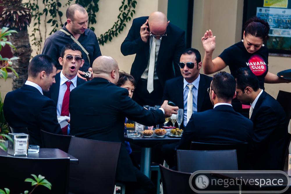 Groomsmen at the Havana Club, Giordini Naxos, Sicily, Italy