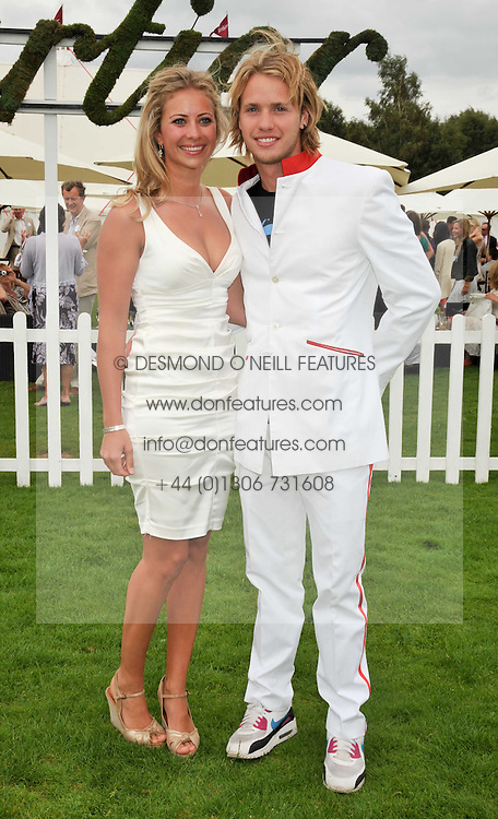 Left to right, HOLLY BRANSON and SAM BRANSON  at the 25th annual Cartier International Polo held at Guards Polo Club, Great Windsor Park, Berkshire on 26th July 2009.