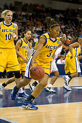 UCSB guard Chisa Ononiwu (3) clears a rebound and dribbles up court.  The #4 seed/#24 ranked Virginia Cavaliers defeated the #13 seed Santa Barbara Gauchos 86-52 in the first round of the 2008 NCAA Division 1 Women's Basketball Championship at the Ted Constant Convocation Center in Norfolk, VA on March 23, 2008