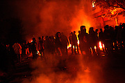 Youngsters stand in the middle of a fire in downtown Cairo as clashes erupt near the Interior Ministry.