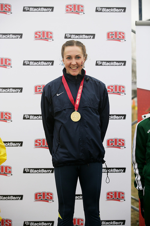 (Kingston, Ontario -- 14 Nov 2009)  Megan Brown of the University of Toronto with her gold medal at the 2009 Canadian Interuniversity Sport CIS Cross Country Championships at Forth Henry Hill in Kingston Ontario. Photograph copyright Sean Burges / Mundo Sport Images, 2009.