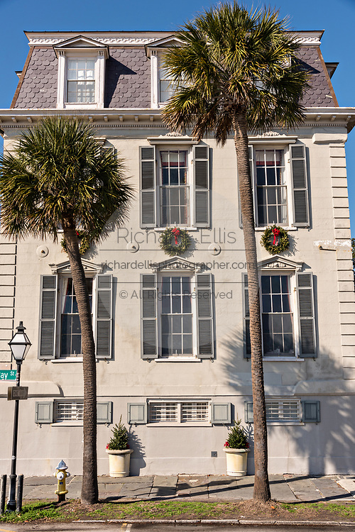 A historic home on the Battery decorated with a Christmas wreaths in Charleston, SC.