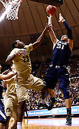 WEST LAFAYETTE, IN - DECEMBER 01: Isaiah Philmore #31 of the Xavier Musketeers shoots the ball against Jay Simpson #23 of the Purdue Boilermakers at Mackey Arena on December 1, 2012 in West Lafayette, Indiana. Xavier defeated Purdue 63-57. (Photo by Michael Hickey/Getty Images) *** Local Caption *** Isaiah Philmore; Jay Simpson