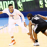 06 May 2016: San Antonio Spurs forward Kawhi Leonard (2) defends on Oklahoma City Thunder guard Russell Westbrook (0) during the San Antonio Spurs 100-96 victory over the Oklahoma City Thunder, during Game Three of the Western Conference Semifinals of the NBA Playoffs at the Chesapeake Energy Arena, Oklahoma City, Oklahoma, USA.