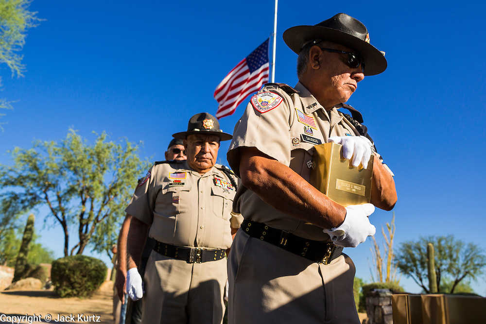 08 OCTOBER 2013 - PHOENIX, AZ:  A member of Veterans Of Foreign Wars honor guard unit holds an urn containing the cremated remains of a US military veteran. The cremated remains of 36 unclaimed US military veterans were interred at the National Memorial Cemetery in Phoenix. Members of the US military and several hundred veterans of the US military attended the service, which was a part of the Missing In America Project (MIAP).   PHOTO BY JACK KURTZ