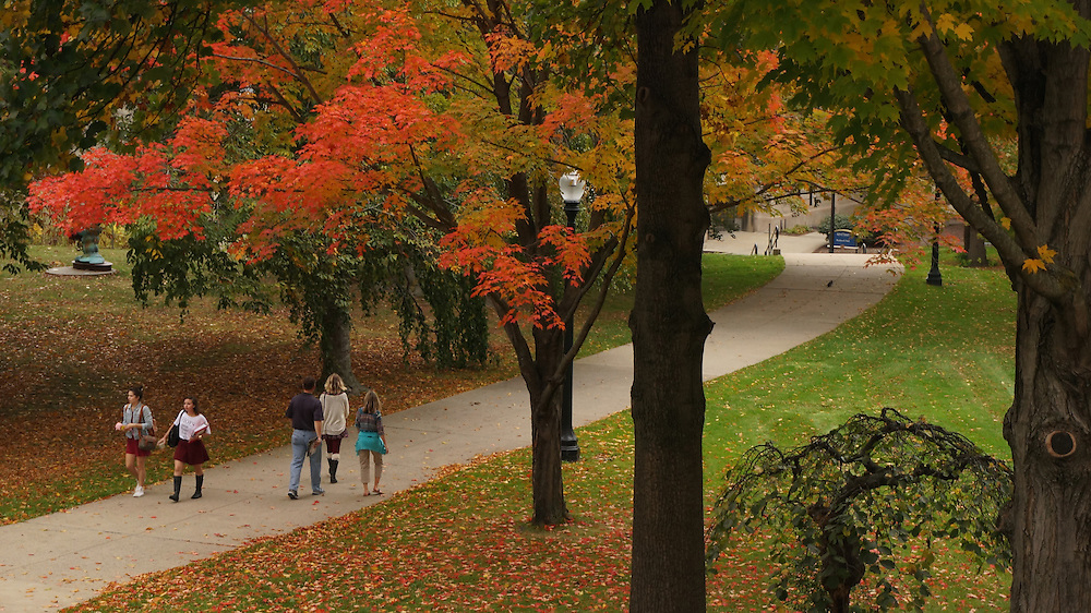 Students and parents walk around the front campus area of the Kent State University campus in Kent, Ohio on a warm fall afternoon.