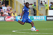 AFC Wimbledon defender Deji Oshilaja (4) passing the ball during the EFL Sky Bet League 1 match between AFC Wimbledon and Scunthorpe United at the Cherry Red Records Stadium, Kingston, England on 15 September 2018.