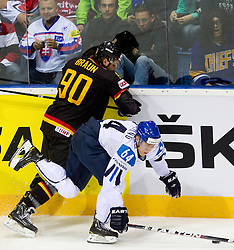 Constantin Braun of Germany vs Mikael Granlund of Finland during ice-hockey match between Germany and Finland of Group E in Qualifying Round of IIHF 2011 World Championship Slovakia, on May 6, 2011 in Orange Arena, Bratislava, Slovakia. (Photo By Vid Ponikvar / Sportida.com)
