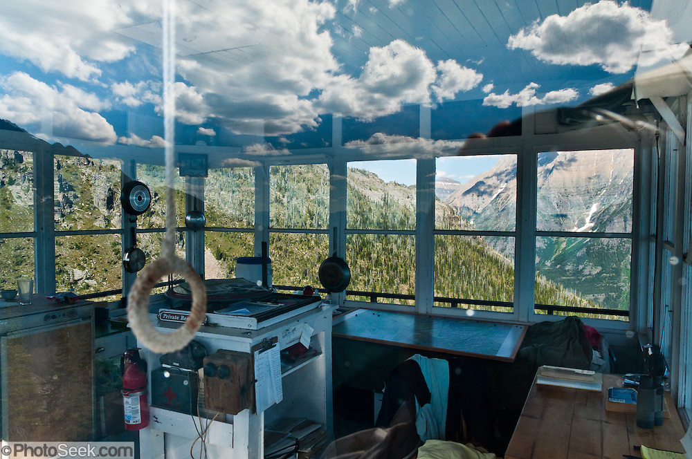 Numa Ridge Lookout glass reflects sky and clouds in Glacier National Park, Montana, USA