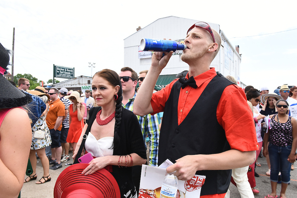 Stacy Wright, left, and Jeremy Barnett, both of Louisville, finish off their beer before entering at Gate 3, the entrance to the infield for the 142nd running of the Kentucky Derby. May 7, 2016