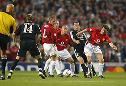 MANCHESTER, ENGLAND - Wednesday, April 23, 2003: Real Madrid's Zinedine Zidane is crowded out by Manchester United's Roy Keane during the UEFA Champions League Quarter Final 2nd Leg match at Old Trafford. (Pic by David Rawcliffe/Propaganda)
