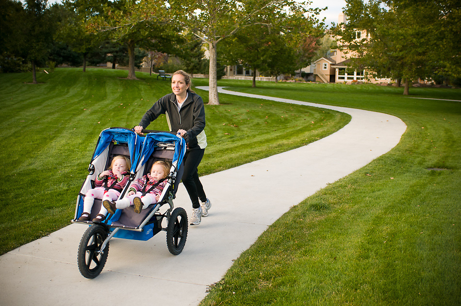 Idaho. Boise. Baggley Park. Woman with twin girls in stroller running. MR
