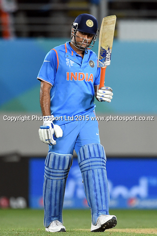 Indian captain MS Dhoni acknowledges the cheers after his fifty during the ICC Cricket World Cup match between India and Zimbabwe at Eden Park in Auckland, New Zealand. Saturday 14 March 2015. Copyright Photo: Raghavan Venugopal / www.photosport.co.nz