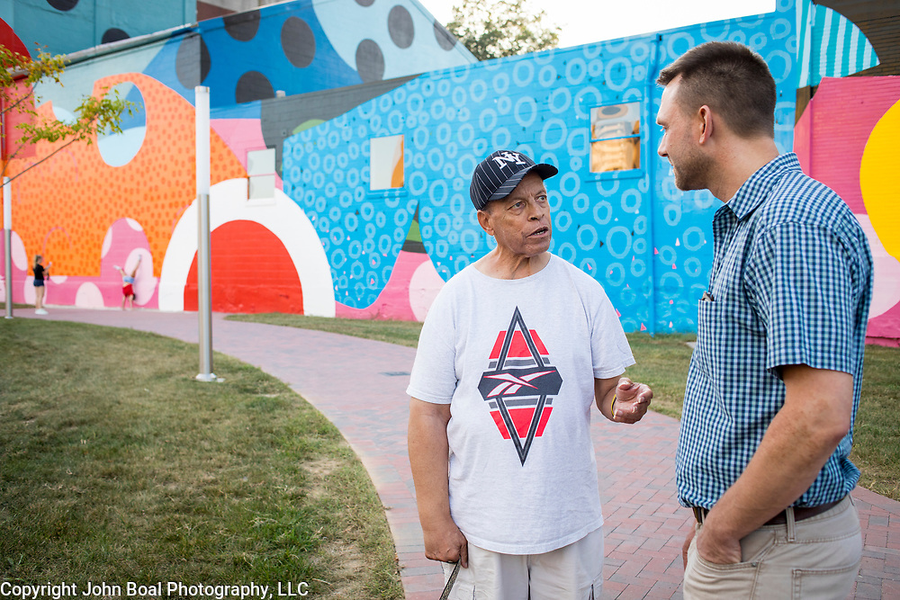 Former Hagerstown Mayor, David Gysberts, right, speaks with Herman &quot;Skip&quot; Davis near a gigantic mural painted on the side of a former grain mill in downtown Hagerstown, Maryland, on Tuesday, September 26, 2017. The mural was the last contract that Gysberts signed before leaving office last year. Originally a District that was mostly rural, but included towns like Frederick and Hagerstown, Maryland's 6th District was redistricted in 2011, combining rural northern Maryland regions with more affluent communities like near Washington D.C. turning the district from Republican to Democrat. <br />  <br /> CREDIT: John Boal for The Wall Street Journal<br /> GERRYMANDER