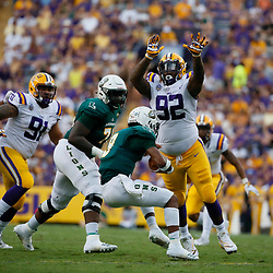 Sep 8, 2018; Baton Rouge, LA, USA; LSU Tigers defensive end Neil Farrell Jr. (92) sacks Southeastern Louisiana Lions quarterback Chason Virgil (9) during the first quarter of a game at Tiger Stadium. Mandatory Credit: Derick E. Hingle-USA TODAY Sports