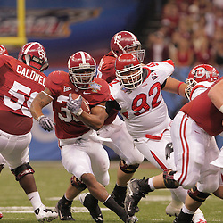 2 January 2009: Alabama running back Glen Coffee (38) runs past Utah defensive tackle Kenape Eliapo (92) during the 75th annual All State Sugar Bowl  between the Utah Utes and the Alabama Crimson Tide at the Louisiana Superdome in New Orleans, LA.