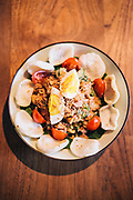 Gado Gado Kaum (assorted blanched garden vegetables tossed in a white cashew and peanut dressing, served with fried shallots, free range egg, tempeh and garlic crackers) from Kaum restaurant atPotato Head Hong Kong