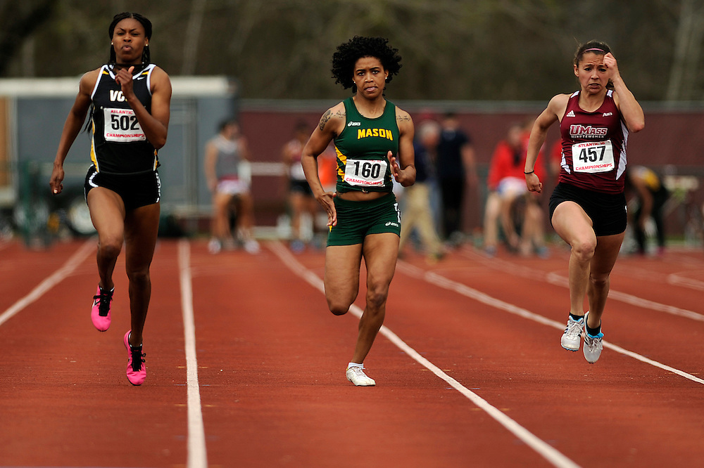 AMHERST, MA - MAY 3: From left, Qualitra Brown of Virginia Commonwealth University, Briana Hill of George Mason University and Ashley Palmer of the University of Massachusetts Amherst race during the women's 100-meter preliminary rounds during Day 1 of the Atlantic 10 Outdoor Track and Field Championships at the University of Massachusetts Amherst Track and Field Complex on May 3, 2014 in Amherst, Massachusetts. (Photo by Daniel Petty/Atlantic 10)
