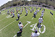 SAN DIEGO - JUNE 10:  General view of San Diego Chargers players stretching and warming up prior to minicamp practice at the San Diego Chargers Park practice field on June 10, 2006 in San Diego, CA. ©Paul Anthony Spinelli