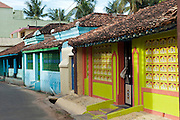 Street in Nagapattinam with row of colourful homes.