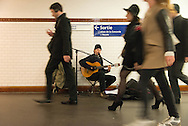 France. Paris. Antoine Baret singing with his guitar  in the  subway