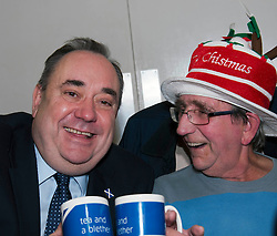 First Minister Alex Salmond, accompanied by Santa Clause, visited the Dean Club in Stiockbridge Edinburgh today to distribute Christmas presents to the residents. Hugh Copland enjoyed a joke with the First Minister (c) GER HARLEY | StockPix.eu