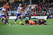 Both Scunthorpe United striker Ivan Tony (9) and Rotherham United Goalkeeper Marek Rodak (13) reach for the ball during the EFL Sky Bet League 1 match between Scunthorpe United and Rotherham United at Glanford Park, Scunthorpe, England on 10 February 2018. Picture by Craig Zadoroznyj.