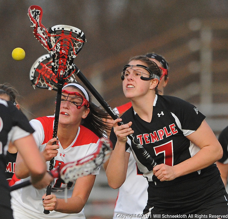 Rutgers sophomore attacker Megan Clements (18) and Temple junior midfielder Megan Chalda (7) battle for a loose ball. Temple defeated Rutgers 12-11 in NCAA women's college lacrosse at the Rutgers Turf Field in Piscataway, N.J.