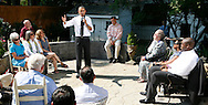 President Barack answers questions about the Health Care Plan with a group in the backyard of the home of Paul and Frances Brayshaw..  Photo by Dennis Brack