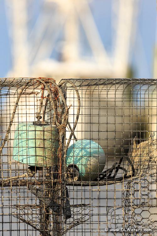 Crab traps and commercial fishing trawler in Wanchese on the Outer Banks of NC.