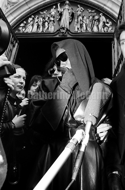 NEW YORK - APRIL 1:  Jamaican American singer, model and actress, Grace Jones, wearing dark sunglasses emerges from St. Patrick's Cathedral, surrounded by photographers and news media after attending Andy Warhol's memorial service on April 1, 1987 in New York City, New York.  (Photo by Catherine McGann).Copyright 2010 Catherine McGann
