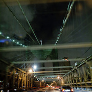 Driving on Brooklyn Brdige by night
