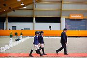 Prijsuitreiking L2 cat AB 1. Finn van Casteren - Mr Moos, 2. Roos de Jong - Brenda, 3. Rosanne Copier - Rakt's Danny<br /> KNHS Indoorkampioenschappen 2020<br /> © DigiShots