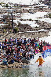 """""""Cushing Classic at Squaw Valley 12"""" - Photograph of a skier crossing a pond during the Cushing Classic at Squaw Valley, USA."""