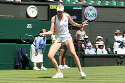 © Licensed to London News Pictures. 03/07/2018. London, UK. Naomi Broady of the United Kingdom plays Garbine Muguruza of Spain in the women's 1st round singles draw of the Wimbledon Tennis Championships 2018. Photo credit: Ray Tang/LNP