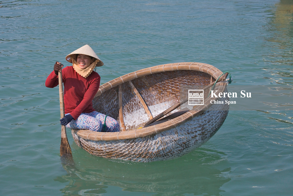Girl with conical hat in bamboo made basket boat, Nha Trang,  Vietnam