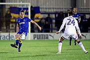 AFC Wimbledon midfielder Anthony Hartigan (26) passing the ball during the EFL Trophy match between AFC Wimbledon and Luton Town at the Cherry Red Records Stadium, Kingston, England on 31 October 2017. Photo by Matthew Redman.