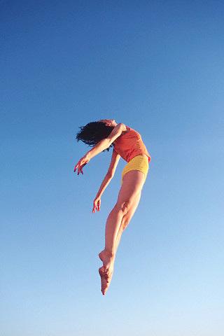 Airborne dancer --- Image by © Jim Cummins/CORBIS