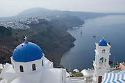 Blue church cupola at Imerovigli. View over Thira and the Caldera, Sea Cloud moored below.